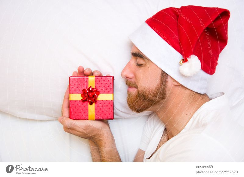 Man with santa hat and gift box Face Vacation & Travel Bed Bedroom Feasts & Celebrations Christmas & Advent Adults Hat Sleep Loneliness Comfortable Attractive