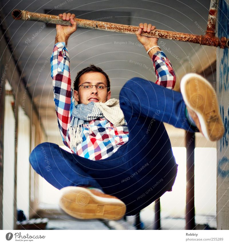 in a jiffy... Masculine Young man Youth (Young adults) Man Adults 1 Human being 18 - 30 years To hold on Hang To swing Jump Athletic Free Muscular Strong Blue