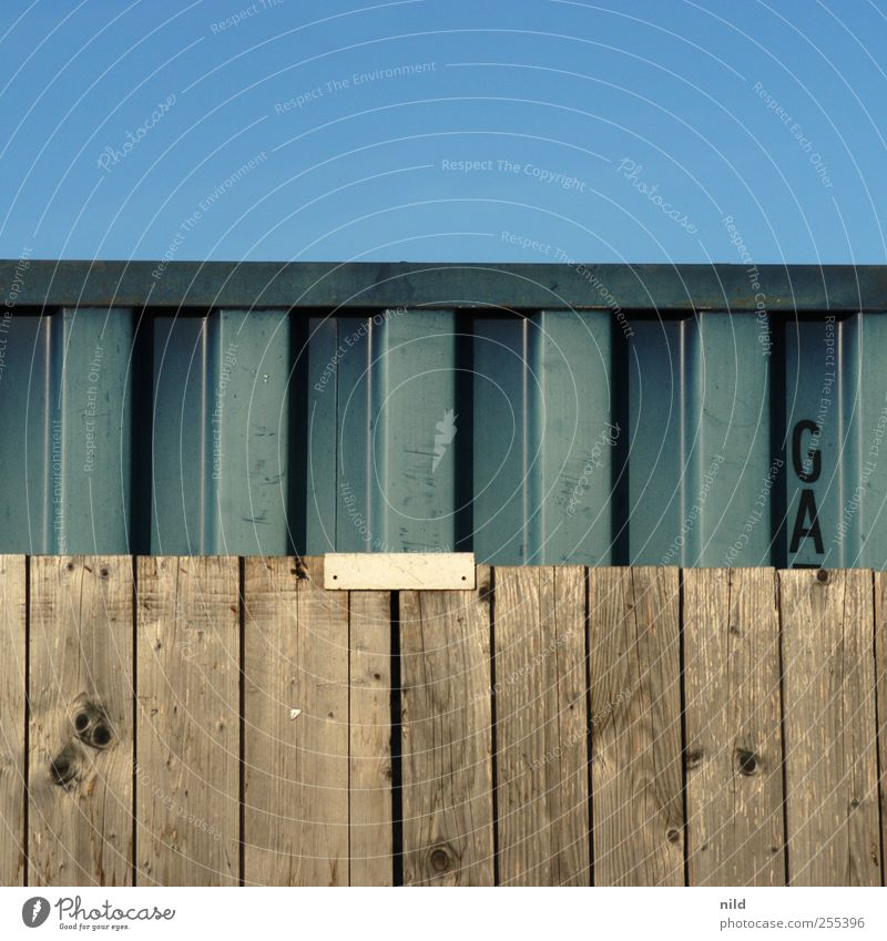For you it's supposed to rain colorful pictures. Sky Cloudless sky Industrial plant Fence Wooden board Container Metal Blue Brown third 3 Square Colour photo