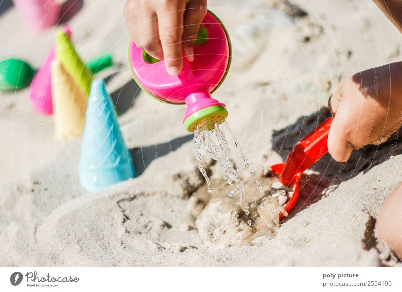 Child plays with watering can on the beach Leisure and hobbies Playing Vacation & Travel Tourism Trip Summer Summer vacation Sun Sunbathing Beach Toddler Girl