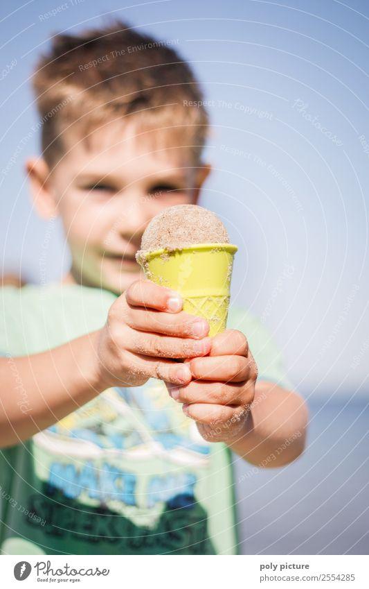 Little boy made an ice cream out of sand. Lifestyle Wellness Vacation & Travel Tourism Trip Adventure Summer Summer vacation Sunbathing Beach Ocean Child