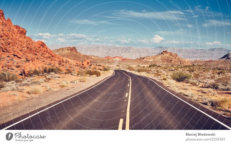 Retro stylized picture of a desert road. Vacation & Travel Tourism Trip Adventure Far-off places Freedom Expedition Camping Cycling tour Summer Summer vacation