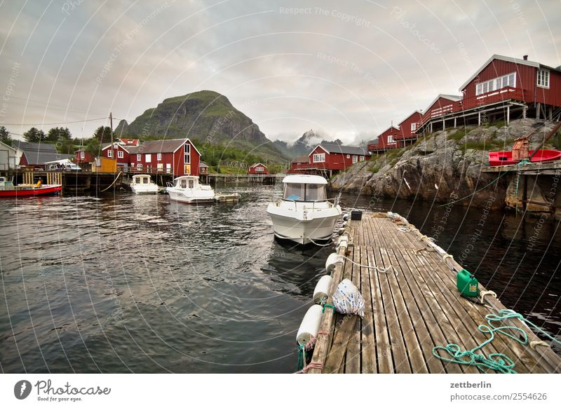 Boats in Å Watercraft Arctic Ocean Europe falun red Rock Vacation & Travel Fisherman Fishermans hut Fjord Harbour Sky Heaven Wooden house Hut Motor barge