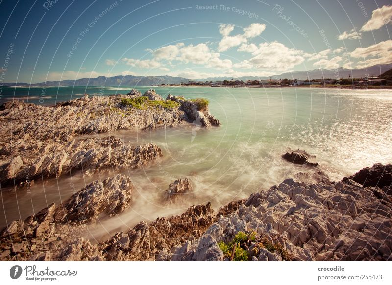 coast Environment Nature Landscape Elements Water Sky Clouds Beautiful weather Rock Waves Coast Beach Bay Ocean Island New Zealand Exceptional Contentment