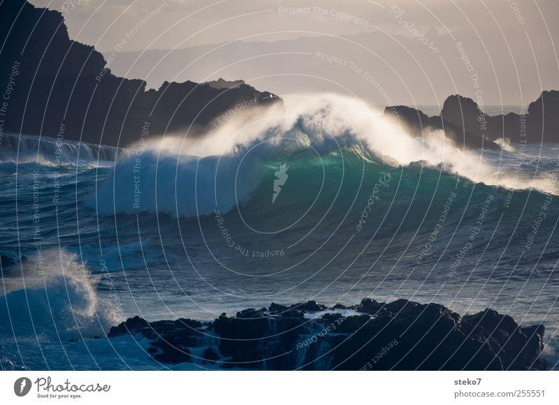 Sky Water Blue Green Ocean Coast Waves Wind Rock To break (something) Surf Cliff White crest Foam