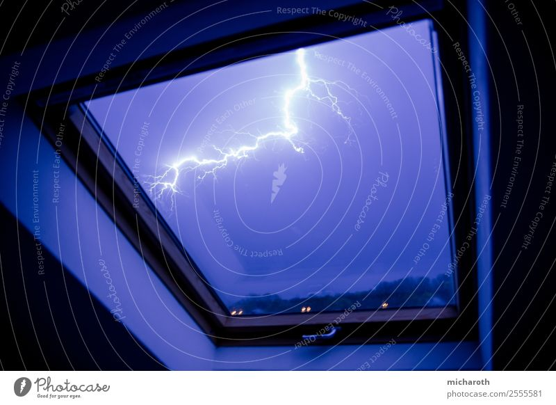Flash in window Environment Nature Sky Storm clouds Climate Weather Bad weather Gale Thunder and lightning Lightning Threat Rebellious Town Blue Violet Fear