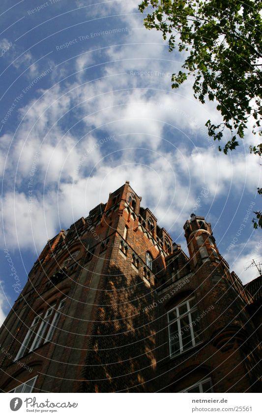 Lüneburg sky Clouds Luneburg Masonry Architecture Tower Sky Blue sky School building Brick construction Worm's-eye view Exterior shot Shadow