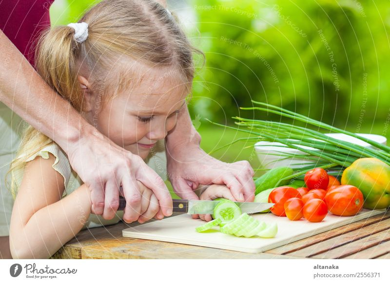 Mother teaches daughter knife cut cucumber Vegetable Eating Dinner Vegetarian diet Diet Lifestyle Summer Table Kitchen Child Human being Adults Nature Steel