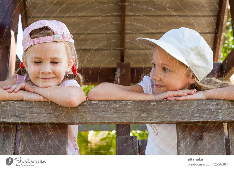 two happy girls standing on the playground Lifestyle Joy Happy Face Relaxation Leisure and hobbies Playing Summer Sports Child Human being Woman Adults