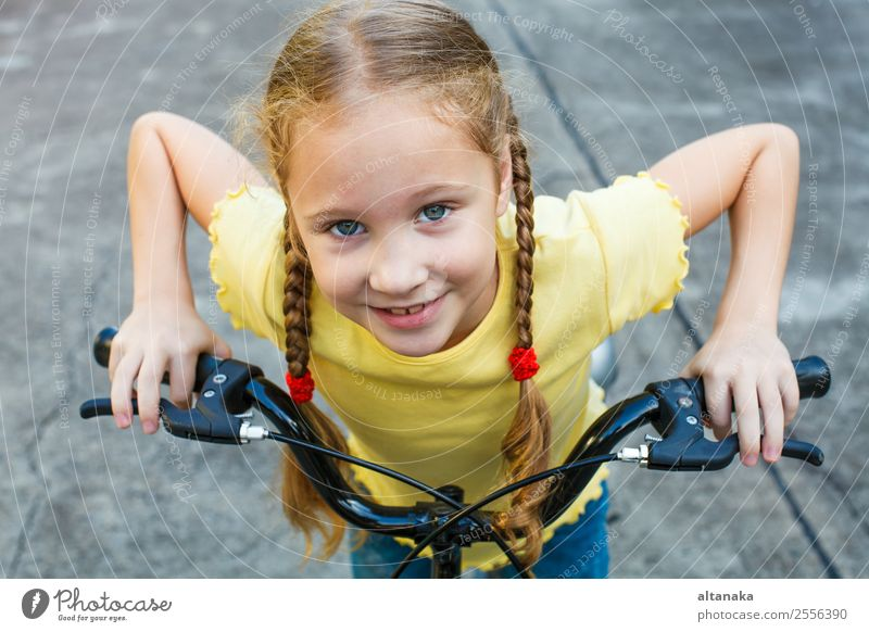 happy child on a bicycle Lifestyle Joy Happy Beautiful Face Leisure and hobbies Playing Vacation & Travel Summer Sports Cycling Child Human being