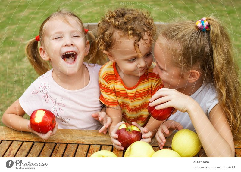 three happy children Woman Child Human being Nature Summer Beautiful Green White Hand Red Joy Face Eating Lifestyle Adults Happy