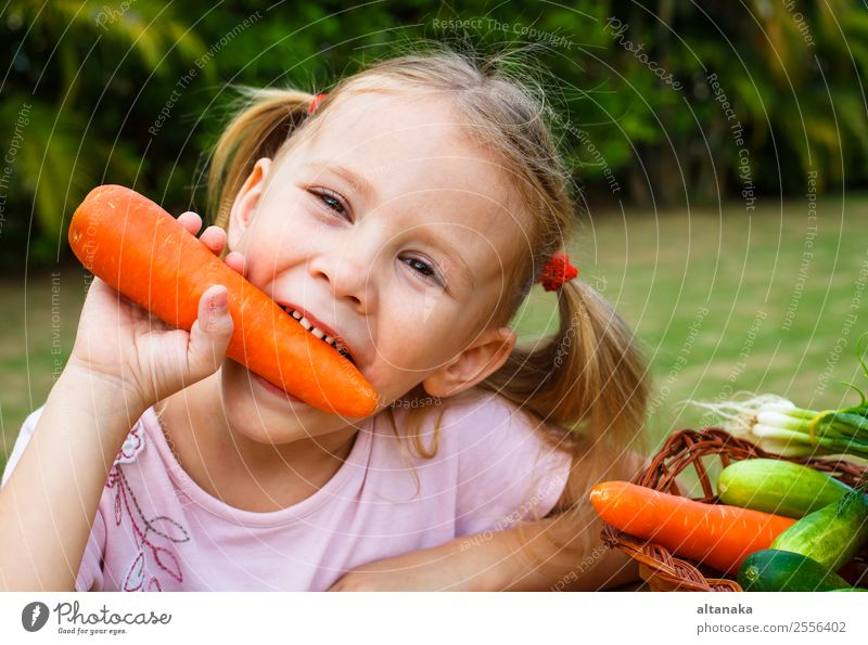 Happy little girl holding a carrots. Vegetable Eating Lifestyle Face Summer Garden Child Gardening Human being Woman Adults Family & Relations Infancy Hand