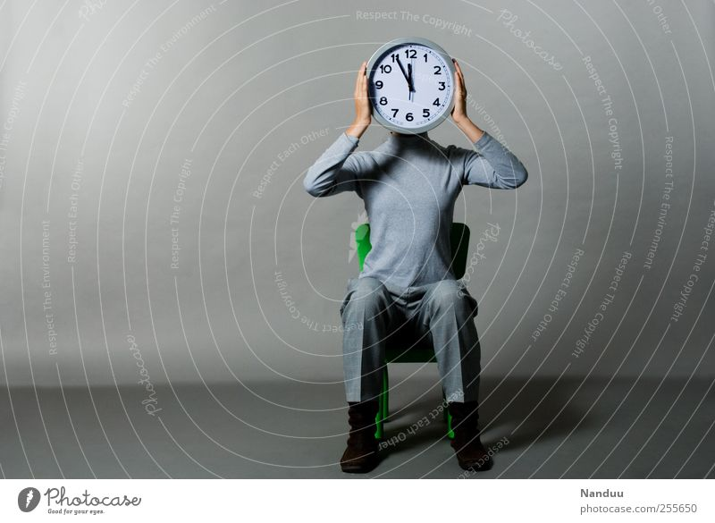 Five to twelve Human being 1 Sit Clock five to twelve Time Sadness Oppressive Gray Compulsion Midday Prompt Haste Business Colour photo Subdued colour