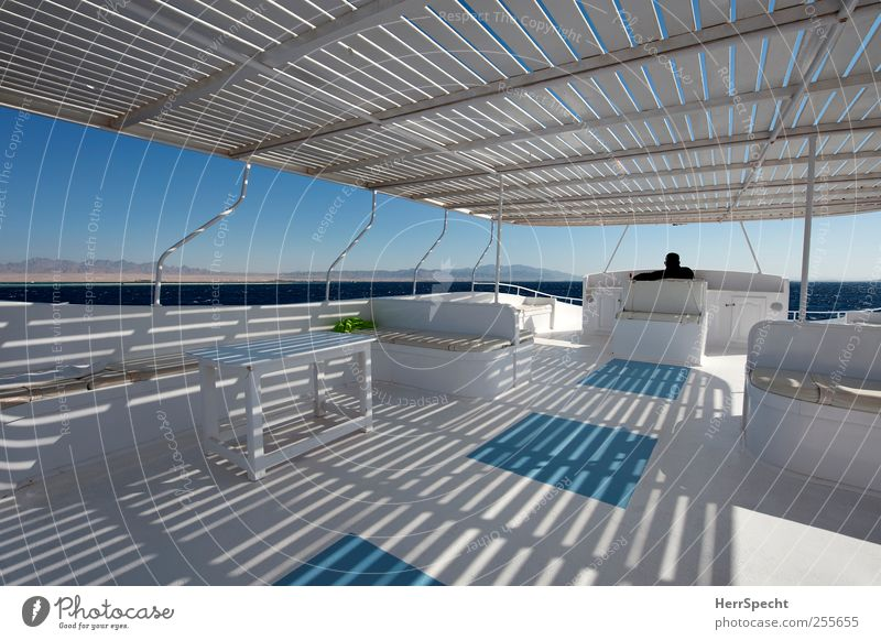 Half shade on the sun deck Vacation & Travel Tourism Trip Far-off places Man Adults 1 Human being 30 - 45 years Coast Ocean Navigation Boating trip Yacht