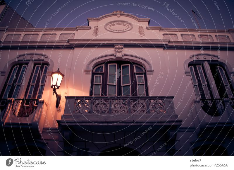 Spanish balcony Cloudless sky House (Residential Structure) Facade Balcony Window Dark Blue Red White Calm Street lighting Architecture Colour photo