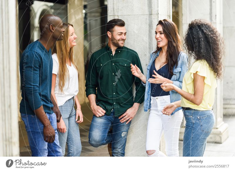 Multi-ethnic group of young people talking outdoors Lifestyle Joy Happy Beautiful Summer Human being Young woman Youth (Young adults) Young man Woman Adults Man