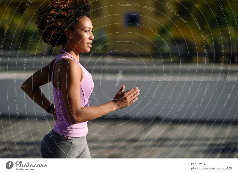 Black woman, afro hairstyle, running outdoors Woman Human being Youth (Young adults) Young woman Beautiful 18 - 30 years Street Lifestyle Adults Feminine Sports