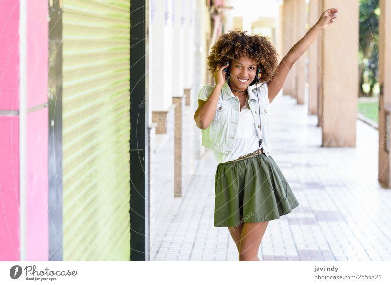 Young attractive black woman in urban street Lifestyle Style Joy Happy Beautiful Hair and hairstyles Face Music Human being Feminine Young woman