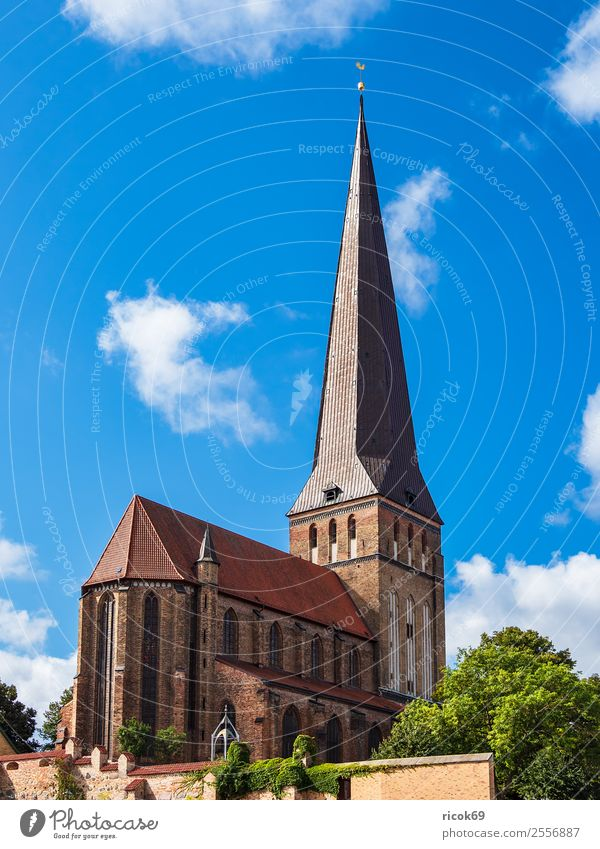 View of the Petrikirche in Rostock Tourism Clouds Tree Town Tower Building Architecture Tourist Attraction Old Historic Blue Belief Religion and faith