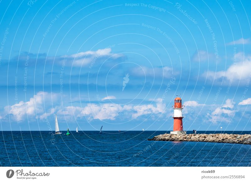 Mole at the Baltic Sea coast in Warnemünde Relaxation Vacation & Travel Tourism Ocean Water Clouds Coast Lighthouse Tourist Attraction Navigation Sailboat