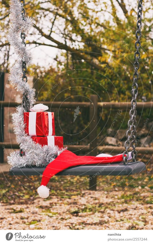 Christmas decorations over a swing in a park Style Design Feasts & Celebrations Christmas & Advent New Year's Eve Nature Climate Weather Snow Snowfall Park Hat