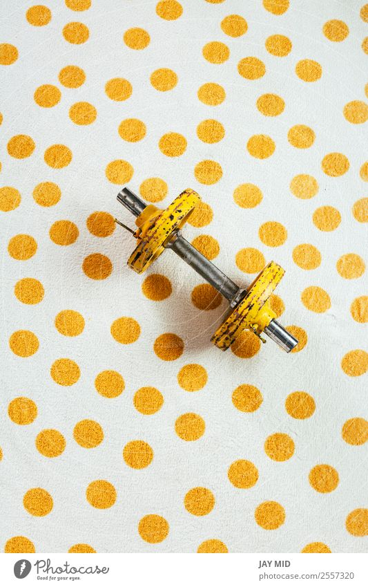 Yellow antique weights on a polka dot towel Lifestyle Sports Fitness Sports Training Martial arts Metal Steel Rust Diet Athletic Free Healthy Strong Power