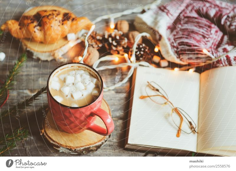 weekly planner or to do list with Christmas decorations Hot Chocolate Coffee Winter Decoration Table New Year's Eve Couple Book Safety (feeling of) Tradition