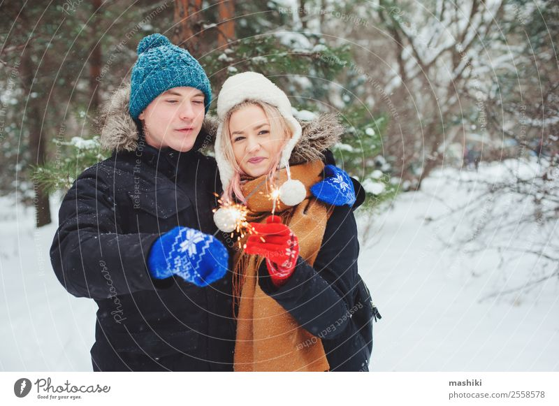 happy young couple walking in winter snowy forest Joy Vacation & Travel Adventure Freedom Winter Snow Winter vacation Woman Adults Man Couple Nature Snowfall
