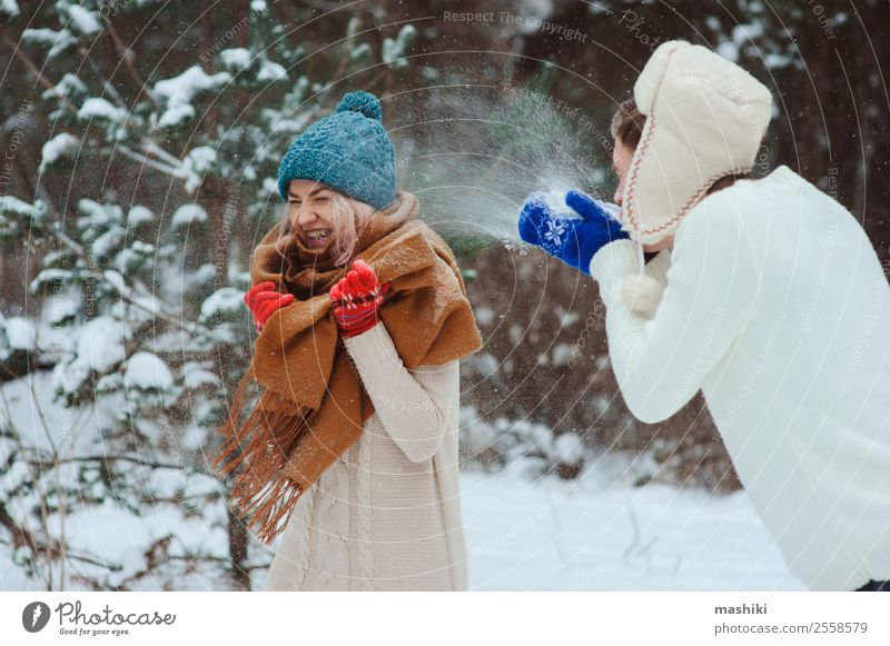 happy young couple playing on winter walk Joy Vacation & Travel Adventure Freedom Winter Snow Woman Adults Man Couple Nature Snowfall Park Forest To enjoy Love