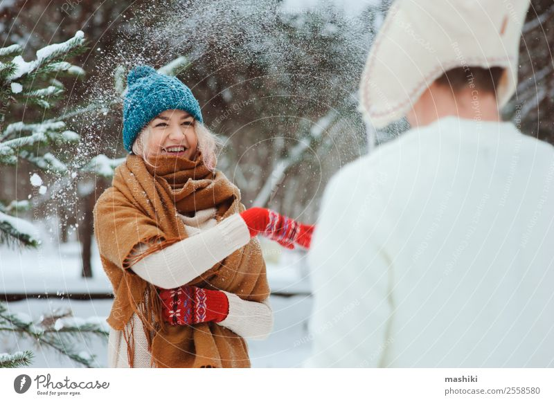 happy young couple playing on winter walk Joy Happy Vacation & Travel Adventure Freedom Winter Snow Couple Nature Snowfall Tree Park Forest To enjoy Love