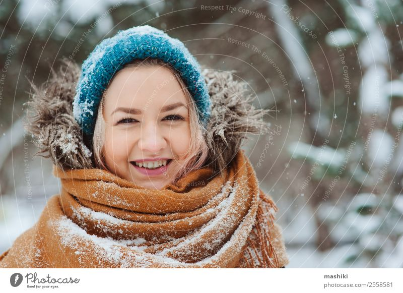 winter portrait of happy young woman Joy Happy Vacation & Travel Adventure Freedom Winter Snow Woman Adults Nature Snowfall Park Forest Fashion Clothing Gloves