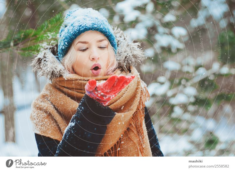 winter portrait of happy young woman Joy Happy Knit Vacation & Travel Adventure Freedom Winter Snow Woman Adults Nature Snowfall Warmth Tree Park Forest Fashion
