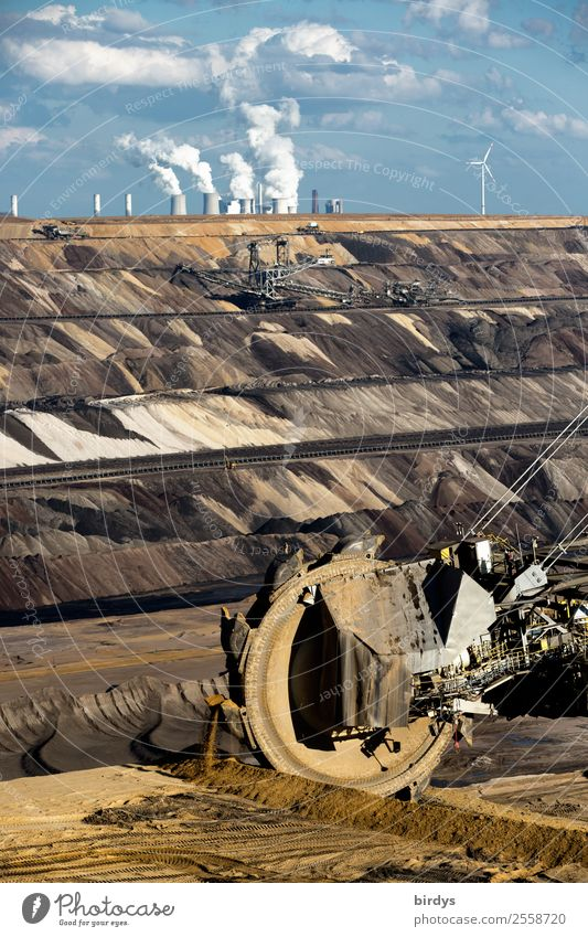 Poisoning the climate, bucket-wheel excavators in the Garzweiler 2 open-cast lignite mine, coal-fired power plant in the background Energy industry