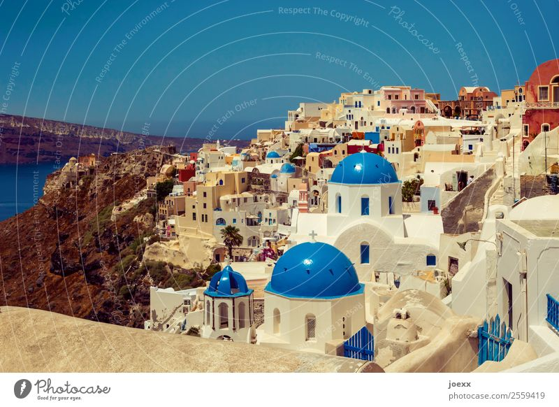 View over the Greek island of Santorini with many houses and blue domed roofs Blue Horizon Summer Island Greece Vacation & Travel House (Residential Structure)