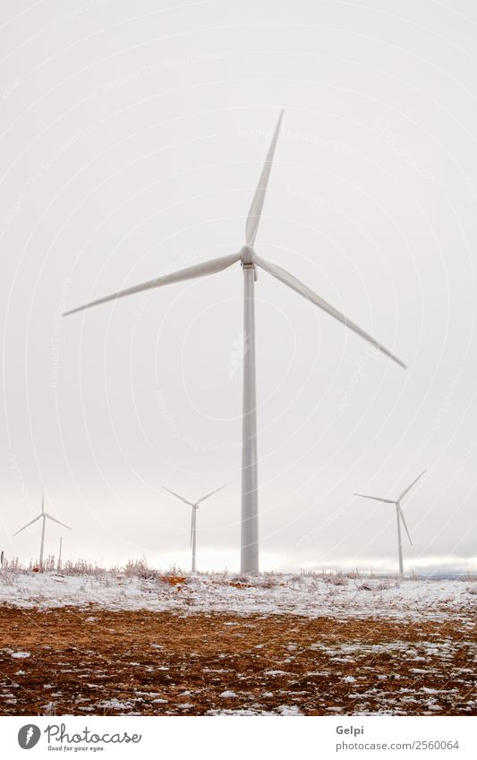 Snowy wind park with many high windmills Winter Industry Technology Wind energy plant Environment Nature Landscape Plant Sky Climate Sustainability Blue Green