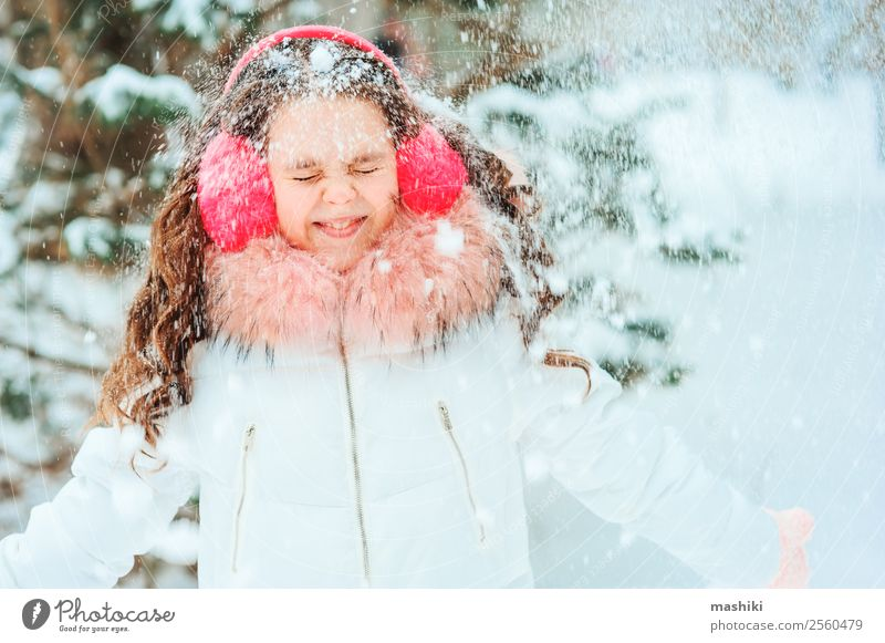 Winter portrait of happy kid girl walking outdoor Child Nature Vacation & Travel Joy Funny Snow Laughter Happy Freedom Snowfall Bright Park Dream Infancy