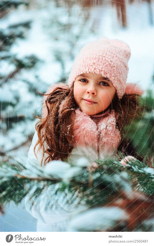Winter portrait of cute smiling child girl in white coat Joy Vacation & Travel Adventure Freedom Snow Winter vacation Child Infancy Nature Snowfall Park Forest