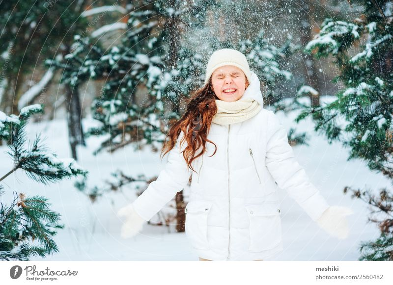 Winter portrait of happy child girl playing outdoor Child Nature Vacation & Travel Tree Joy Forest Funny Snow Laughter Freedom Snowfall Infancy Smiling