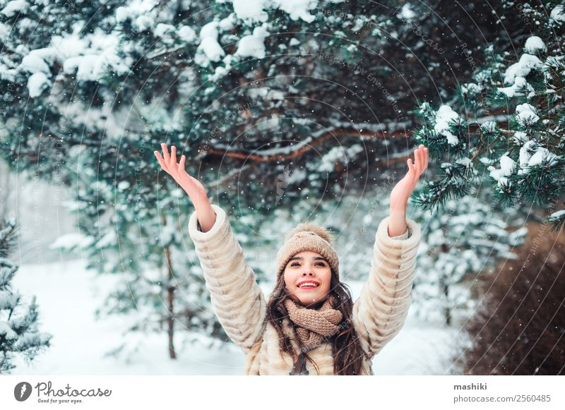 happy woman catching snowflakes in snowy winter forest Woman Nature Vacation & Travel Tree Joy Forest Winter Face Adults Natural Feminine Snow Happy Style