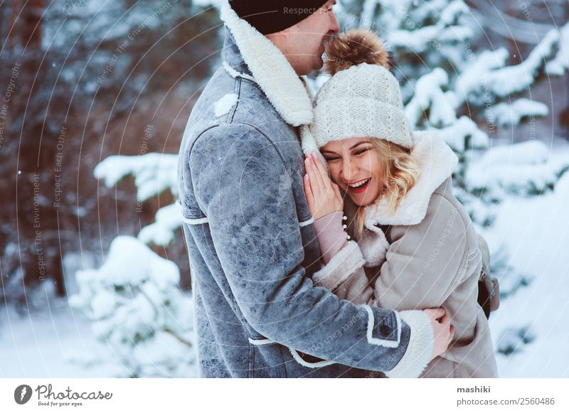 romantic winter portrait of couple embracing in snowy forest Woman Nature Vacation & Travel Man Joy Forest Winter Adults Love Snow Happy Couple Freedom Together