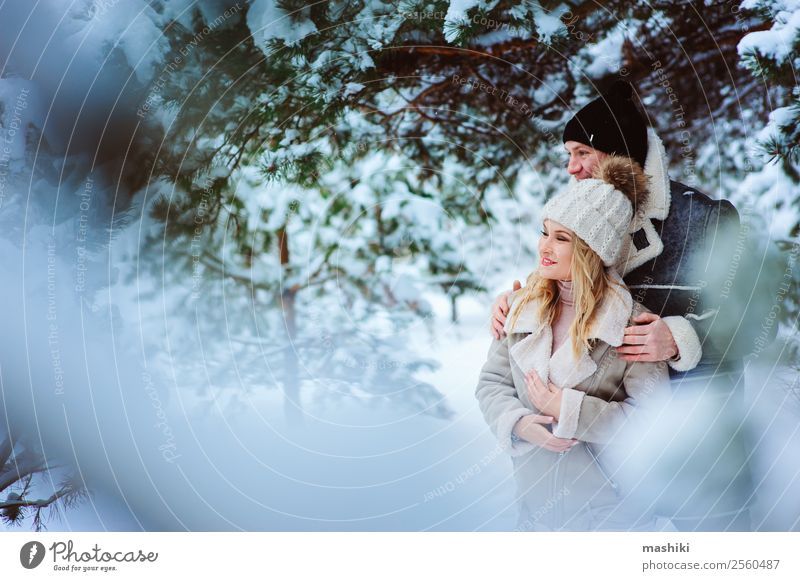 Happy couple spending good day outdoor in snowy winter forest Woman Nature Vacation & Travel Man Tree Joy Forest Winter Lifestyle Adults Love Snow Couple