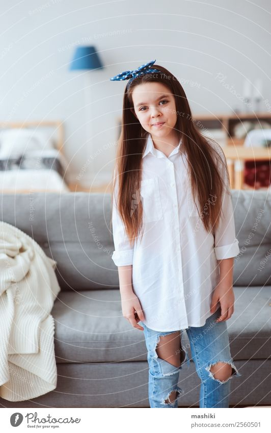 vertical portrait of happy 10 years old preteen girl at home Lifestyle Style Joy Relaxation Living room Child Infancy Fashion Shirt Jeans Dress Smiling