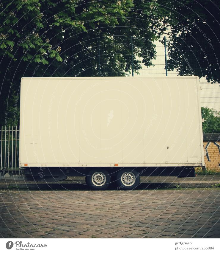White Street Lanes & trails Wall (barrier) Empty Floor covering Logistics Sidewalk Fence Traffic infrastructure Parking Tire Parking lot Paving stone Means of transport Trailer