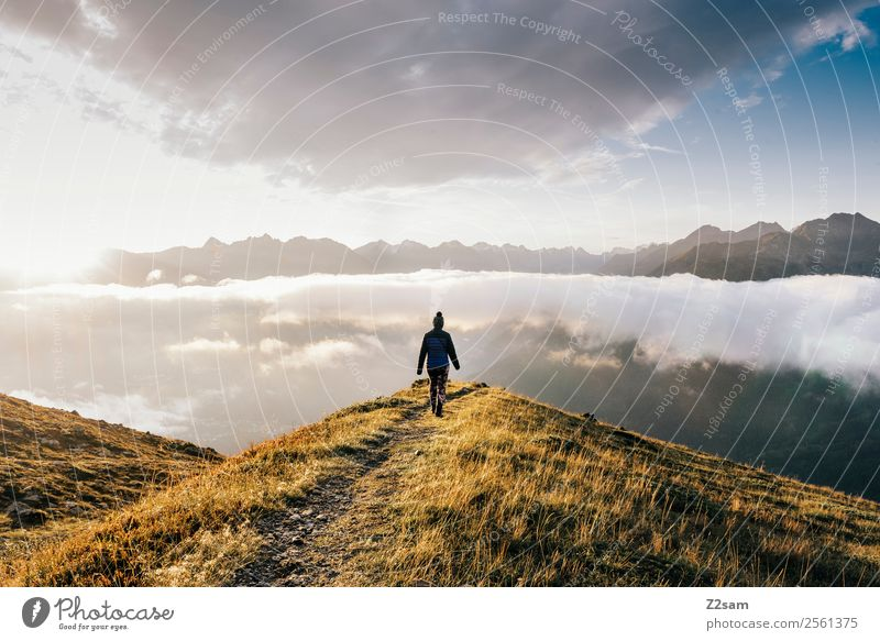 Woman Sky Nature Vacation & Travel Summer Landscape Clouds Far-off places Mountain Adults Natural Feasts & Celebrations Freedom Going Hiking Horizon
