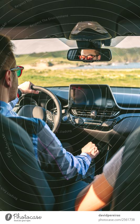 Young man driving a car Lifestyle Vacation & Travel Trip Adventure Technology Human being Woman Adults Man Couple Arm Hand Grass Meadow Coast Transport Vehicle