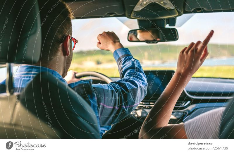 Young man and girlfriend dancing while driving a car Lifestyle Joy Happy Leisure and hobbies Vacation & Travel Trip Adventure Music Human being Woman Adults Man