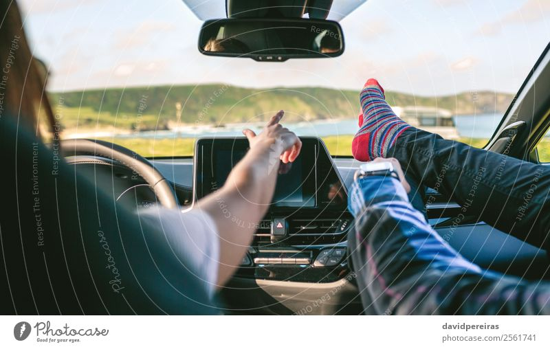 Young couple traveling by car feet up barefoot Woman Human being Vacation & Travel Man Relaxation Joy Lifestyle Adults Coast Trip Leisure and hobbies Car