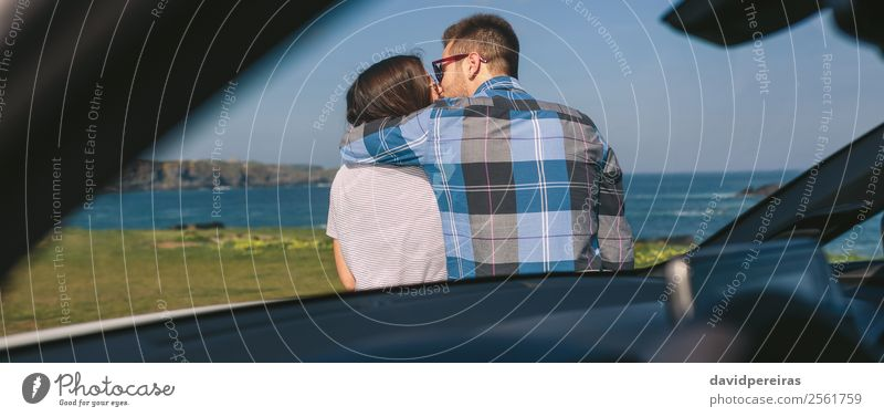 Young couple kissing near the coast Vacation & Travel Trip Adventure Ocean Human being Woman Adults Man Couple Nature Landscape Grass Meadow Coast Car Kissing