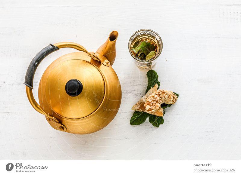 Arabian golden teapot Lunch Dinner Diet Beverage Tea Culture Flower Blossom Dark Fresh Delicious Above Specialities sakura oriental Copy Space Gourmet