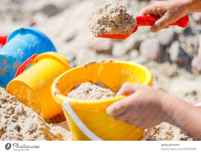 Child shovels sand on the beach Vacation & Travel Tourism Far-off places Freedom Summer Summer vacation Sunbathing Beach Ocean Island Toddler Girl Boy (child)